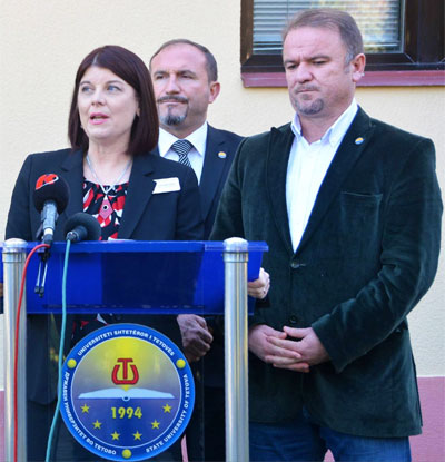 NIU Provost Lisa Freeman joins the University of Tetovo's Vullnet Ameti (center) and Arbër Çeliku at a 2015 dedication of the Center for Peace and Transcultural Communication.