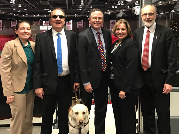 James Fruchterman (center), pictured with (from left) Stacy Kelly, Gaylen Kapperman, Laurie Elish-Piper and Doug Baker, received an honorary doctorate during Saturday's Graduate School commencement ceremony. Click the photo to read more about Fruchterman's recognition.