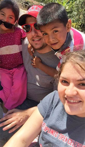 T.J. Schoonover (top center) made some young friends in Guatemala.