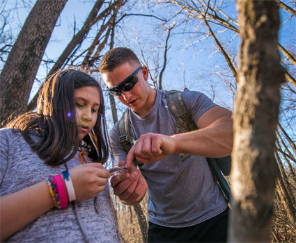 Nick Wiltsie helps fifth-grader Angelina Sifuentes with her compass.