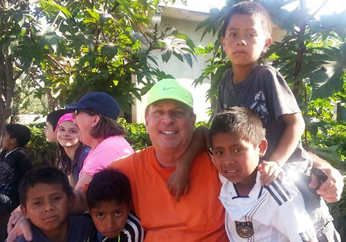 Scott Wickman visits with Guatemalan children.