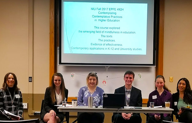 Sassone (left) and her students present March 6 at the Engaged Learning, Teaching and Scholarship Conference: Celebrating High Impact Learning at NIU.