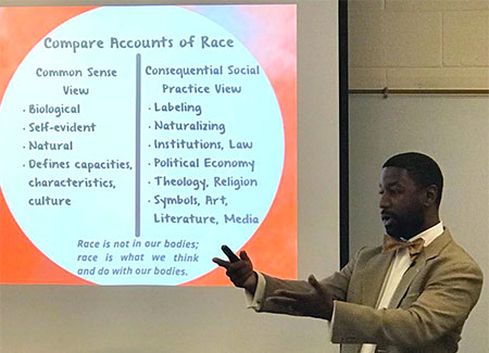 "Marcus Croom presenting ""Developing Racial Literacies: Discussing the Consequential Social Practice View of Race."""