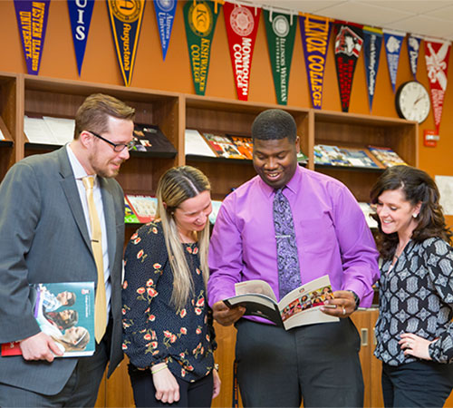 DeKalb High School leaders with NIU Principal Prep degrees include (from left) Sean Potts, assistant principal for Curriculum and Instruction; Julie Daniels, dean of students; Maurice McDavid, dean of students; and Donna Larson, assistant principal for Student Services and Operations.