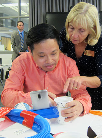 Downey taught science lessons about sound to Chinese visitors to the NIU College of Education.