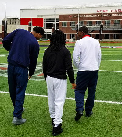 Three young men from the Illinois Youth Center in St. Charles visit the NIU campus as guests of Project FLEX