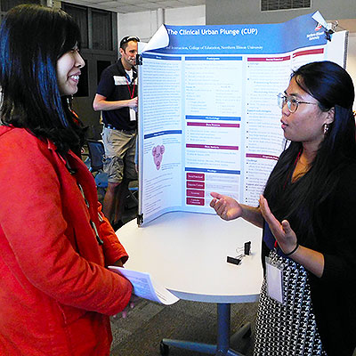 Solano explains her project to Pi-Sui Hsu during the Student Research Symposium.