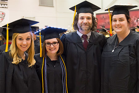 Congratulations! Morrison and Goodin (along with classmates Valerie Hartgraves, second from left, and Bryanna Scharre) graduated from NIU in May.