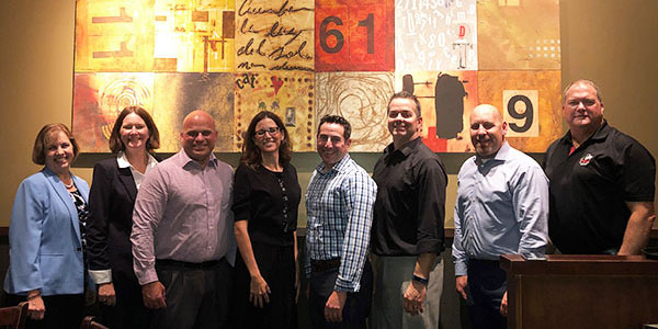 Danny Oest (far right) celebrates with graduates of a recent Hoffman Estates-based cohort of the Ed.S. in Educational Administration program. Joining Oest, from left: Dean Laurie Elish-Piper, Department Chair Carolyn Pluim, Matt Birdsley, Susan Redell, Jason Klein, Adam Parisi, Jason Dietz.