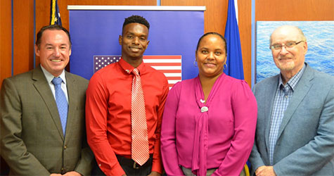 From left: Joaquin Monserrate, Charge d'affaires at the U.S. Embassy; Fulbright Foreign Scholar Matthew St. Bernard of Barbados; Nutrice Francis; and Gary McElhiney, Acting Public Affairs Officer at the U.S. Embassy.