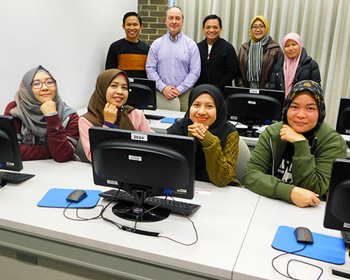 Paul Wright (back row, second from left) led workshops for the PKPI scholars.