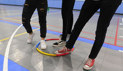"Only three pairs of feet were allowed in the hoops during this roung of ""Let's Get Together."""