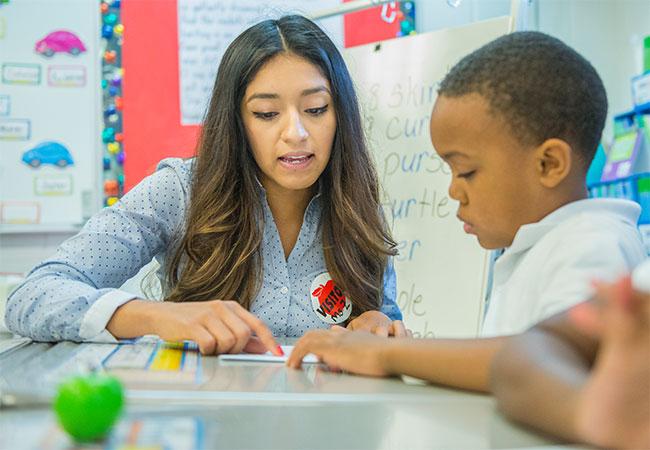 Aimee Zepda tutors a student through the Open Doors project.