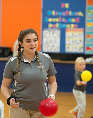 NIU P.E. major Christin Gurrieri works in the Genoa-Kingston gym during her clinical placement.