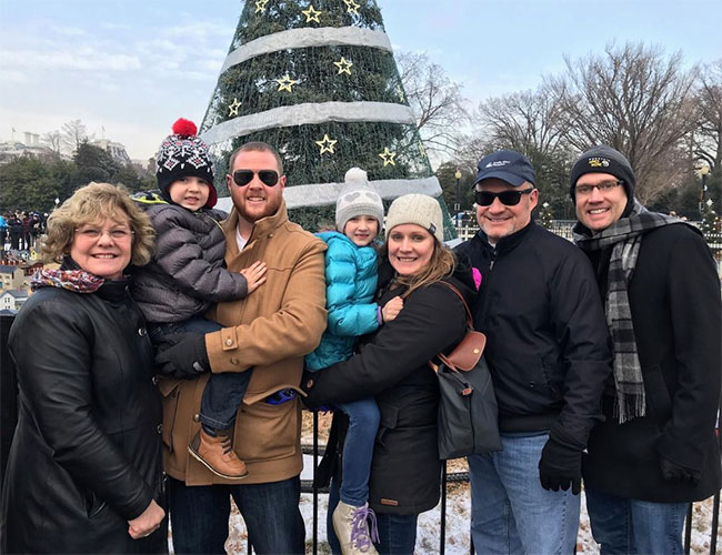 Robin Miller-Young, grandson Ryan Ball, son-in-law Matt Ball, granddaughter Emma Ball, daughter Meagan Ball, husband Rich Young and son Matthew Young visit the White House Christmas tree.