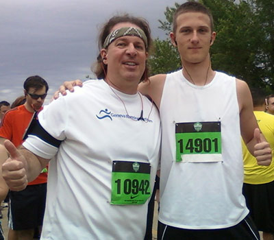 Wickman and his son, Ethan Connor, outside Soldier Field after running in a 10-mile race.