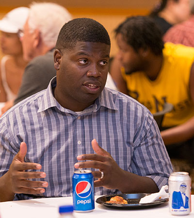 Maurice McDavid engages in conversation during a 2018 Unity Walk event on the NIU campus.